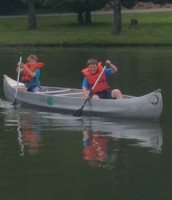Mason and Luke bringing in their canoe!