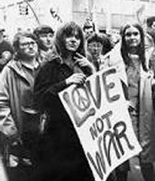 The Counter Culture Movement- Protesters hold a sign in support of peace.