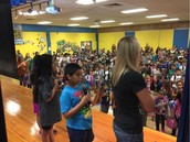 Ms. Allison's 4th Grade Panthers Lead Us In The Pledges At Monday Morning Assembly!