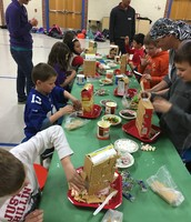 Working hard on our gingerbread houses!
