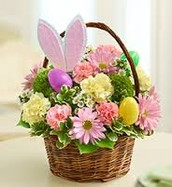 Basket arrangment featuring carnations, daisies, and bunny ears with eggs