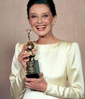 A Smiling Hepburn with an Award