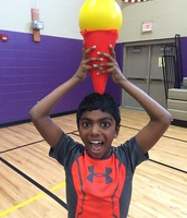 Rahul showing off our WINNING torch! Miss Tigges's class wins the grade competition for the second time in a row. :)