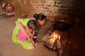 They are burning wood so they can stay warm