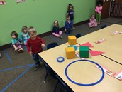 Copeland chooses a shape to match to a big circle , triangle, or square.