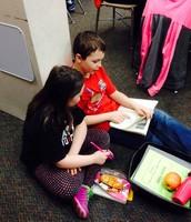 Sara and Ethan take turns Reading to Someone.