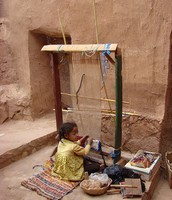 Young girl working on a loom in  Aït Benhaddou, Morocco in 2008