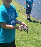 Bryson shows off his fish. Luke waits patiently!
