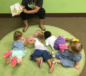 The girls get super comfortable for their story by Renee.