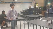 Mr. Haroshima with our Robotics Class