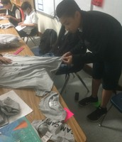 Cutting up T-Shirts for the Earth Day Project