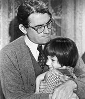Scout hugging Atticus