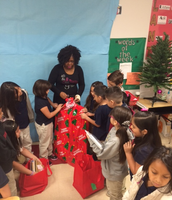 Teachers Opening Literacy Gifts
