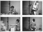 Boy hitting, kicking, and throwing doll
