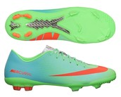 Blue and mint green Nike soccer cleats
