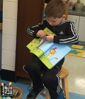Morning meeting - Elijah shared his favorite book - Ten Apples Up On Top by Dr. Seuss