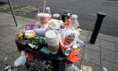 bins over flowing with rubbish