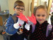 """Kai and Olivia with their """"Fox in Socks"""" puppet"""