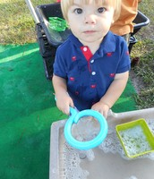 Braxton at the sensory water table