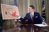 Ronald Reagan announcing on TV one of his policies.