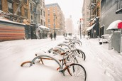 Bikes are covered by snow!