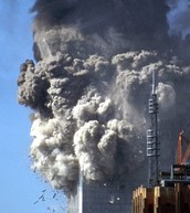 The top of the south tower breaks off, causing the collapse of the building as a whole.