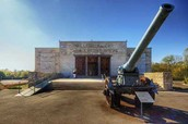 A memorial building and a Cannon from 1916 from the battle of Verdun