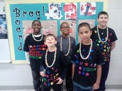 Ms. Lankster's class showing off that they are 100 days smarter on Friday, the 100th day of school
