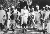 Gandhi leading a salt march, attempting to end the monopoly of the British salt industry