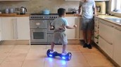 child riding the hover board