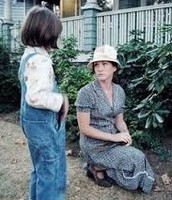 Miss Maudie next to her azaleas, talking to Scout