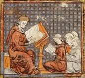 young boys being educated by monks