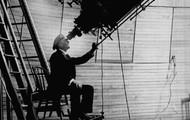 percival looking through telescope