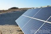 solar panels near a lake
