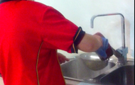 Pouring the water from the noodles