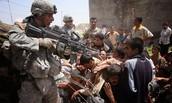Israeli soldier pointing his gun at children