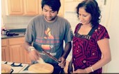 Jay's mother teaching him how to cook Indian a Food.