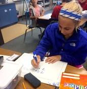 Working hard in math class.