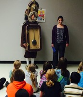 Cogsworth and Ms. Harms read us a story.