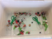 Awesome Spy #3: Using the mini sensory table to sort insects using tongs and specific containers