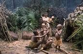 Mbuti Family sitting near their Home