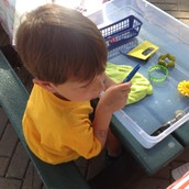 Arlo making a sun out of play dough.