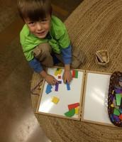 John designing with various shapes