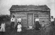 Here is a pioneer family with their house.