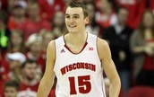 How do we get the median of Wisconsin's wins?