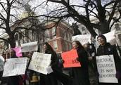 Citizens protestig the Electoral College