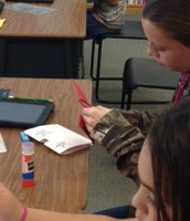 Students working on letters for veterans
