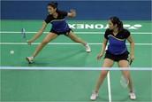 Female Badminton Team Playing Badminton