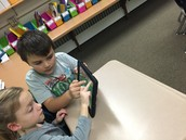 Third graders helping first graders with Kodable