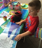 Wyatt reading The Very Grouchy Ladybug